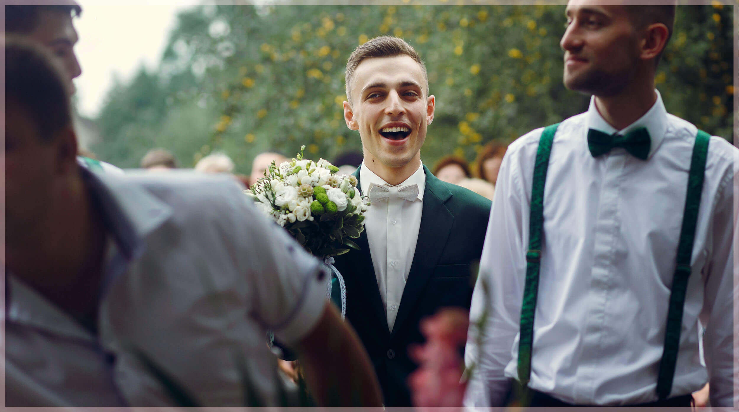 Groom Picture- Grooms laughs while holds the bouquet